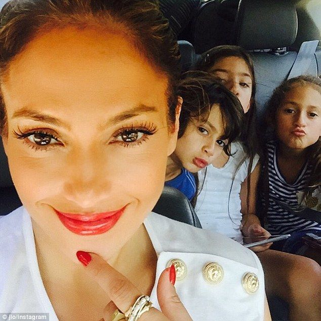 Sweet snap: Jennifer Lopez and her twins Emme and Max and a friend show off their best kissy faces in a cute selfie the singer posted to Instagram on Thursday