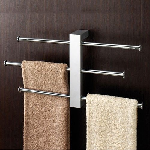 This wall-mounted towel holder features three sliding bars to allow for easy customizability dependent on the size of the towel