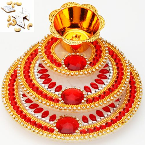 Gift your loved ones this Acrylic Light diya tray adorned with stones to make this a masterpiece by itself. These Diyas have a Cell and a bulb included with it which works as a Light for the same http://www.exoticabazaar.com/view/15067-68-three-layer-light-diya.html