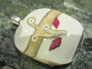 Fused glass pendant with fine silver and copper, playing with chemical reactions www.glassbyclaire.com