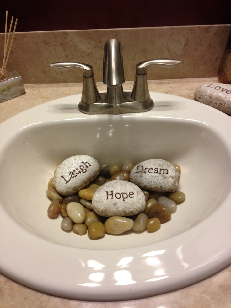 Fill A Guest Sink Partially With Smooth Stones