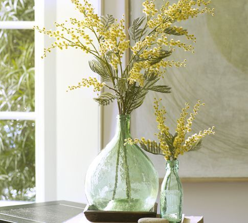 A few simple faux branches arranged in vintage glass creates a beautiful statement and reinforces themes.