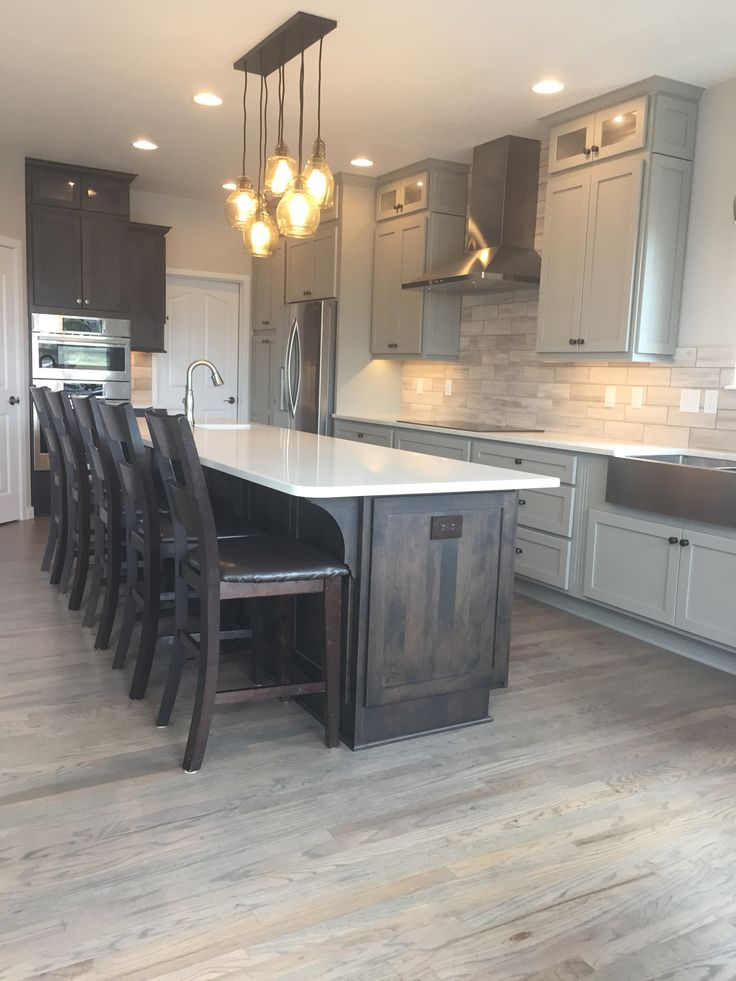 Kitchen remodel. Cabinets-Custom Cupboards in mocha and Boulder grey Counters…