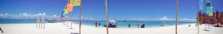 White sand beach and clear blue water of Kalanggaman Island in Palompon Leyte, Philippines. May 01, 2013