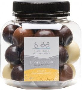 Duck Creek Macadamias Trios: Extreme enjoyment: Our finest macadamia nuts enrobed in a trio of couverture chocolates. A treat for your eyes and your mouth.