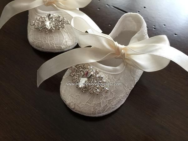 These pre-walking, soft sole baby crib shoes are light and comfortable. They are made with beautiful lace in your choice of French Ivory or White color, and adorned by stunning rhinestones. They are beautifully finished with pearl rhinestones. The satin ribbon completes the vintage design. They are perfect for baby baptism shoes, flower girl shoes, christening shoes, birthday shoes, and baby photo prop shoes.Available Sizes:US Size 1 (Length: 3.75 Inches, Recommended Size: 0-3 Months)US Size…