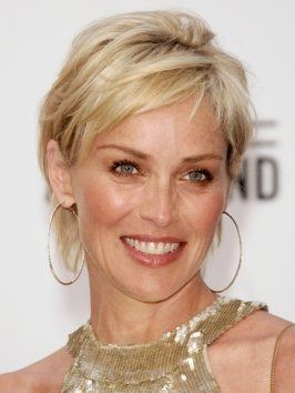 Sharon Stone's growing out her short pixie wearing a soft textured bob with side swept bangs. Layers increase the volume in Sharon's fine blonde hair, giving her bob hairstyle more flair.