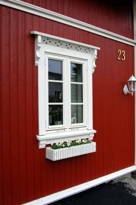 More pretty window trim and vertical siding