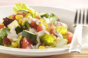 Here's a quick and easy chopped salad you can make on even the busiest weeknight, thanks to thawed frozen corn and OSCAR MAYER Real Bacon Bits.
