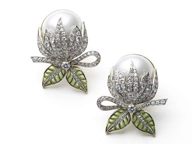 A pair of Moira bud earrings, with mabé pearls, pavé set round brilliant-cut diamonds and green plique à jour enamel leaves, mounted in gold, with white gold settings.
