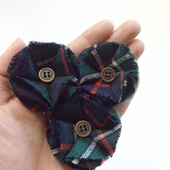 Groom and groomsmen boutonnieres with modern Seaforth Mackenzie tartan and centre button / buttonholes / lapel flowers