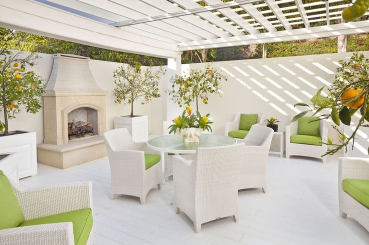 Citrus accents and lots of greenery brighten up an all-white patio.