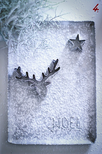 Recreate with canvas, cookie cutters, and spray paint. To add snow like texture use elmers glue or epsom salt, then spary paint over the top?
