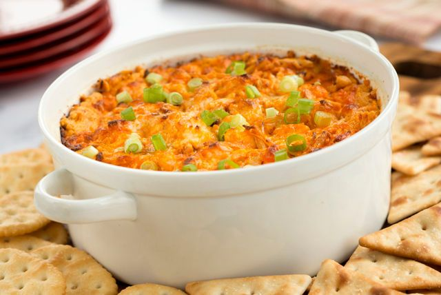 Cream cheese, blue cheese, ranch dressing and hot sauce give this hearty baked chicken dip a familiar Buffalo flair.