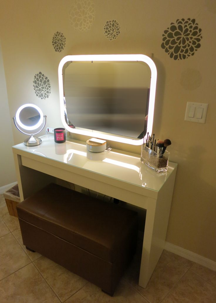 Vanity Makeup Table:  table, mirror (ikea)  daylight cosmetic mirror, wall paper, ottoman, six power connecter,  iHome Radio.