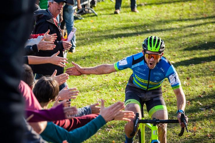 High fives as Michael van den Ham crosses the finish line at the Canadian National Cyclocross Championships in Sherbrooke QC.
