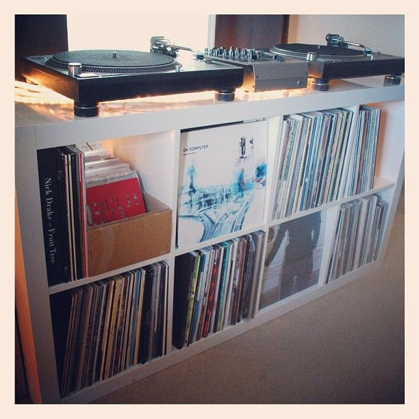 Looks like Expedit (or Kallax) from Ikea and combines record storage and stereo furniture.