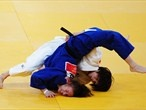 Tomoko Fukumi of Japan and Kelly Edwards of Great Britain compete in the Women's 48kg Judo