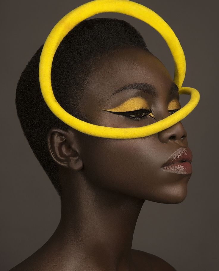 Fave Magazine Photography by Mike Ruiz Headpieces by Penny Chu at iwww.chuchuny.com Model Nyamouch Griwath Makeup by Eliza Davila  i chose this piece because i like how the colour matched the make up. the bright colour against the dark skin tone makes the yellow pop.