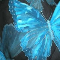 http://www.tafalist.com/members/singingscarves     Blue butterfly painted on silk scarf by artist Maria Jyrimäe of Estonia.  She sings as she paints, thus her business name:  Singing Scarves!