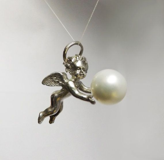 Pendant in sterling silver, with Majorica pearl and very fine details. https://www.etsy.com/listing/226311168/angel-pendant-sterling-silver-baroque?