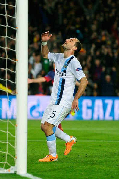 A dejected Pablo Zabaleta of Manchester City reacts after Lionel Messi of Barcelona scores the opening goal during the UEFA Champions League Round of 16, second leg match between FC Barcelona and Manchester City at Camp Nou on March 12, 2014 in Barcelona, Catalonia.