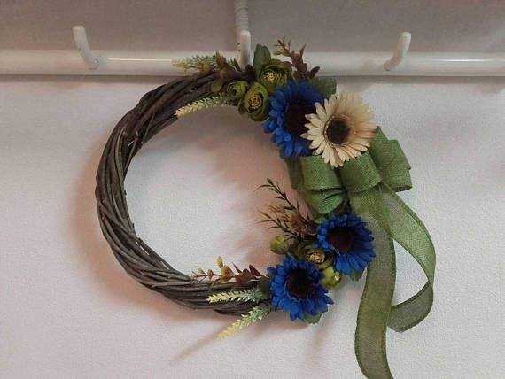 Check out this item in my Etsy shop https://www.etsy.com/listing/558388472/floral-wreathfront-door-wreathvintage