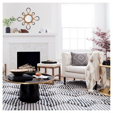 Nate berkus home collection tilework on fireplace for Living room 7 letters