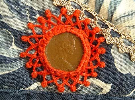 Shi Sha surrounded with a combination of detached chain stitch and fly stitch sealed with a colonial knot…