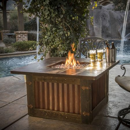 the natural beauty of wood and steel in one beautiful fire pit table homesteader