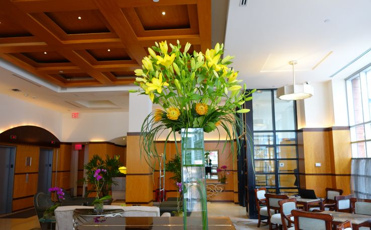 The lobby is filled with flowers and we are all getting excited for the warmer months! #spring #hotel #hotelgiraffe #flowers