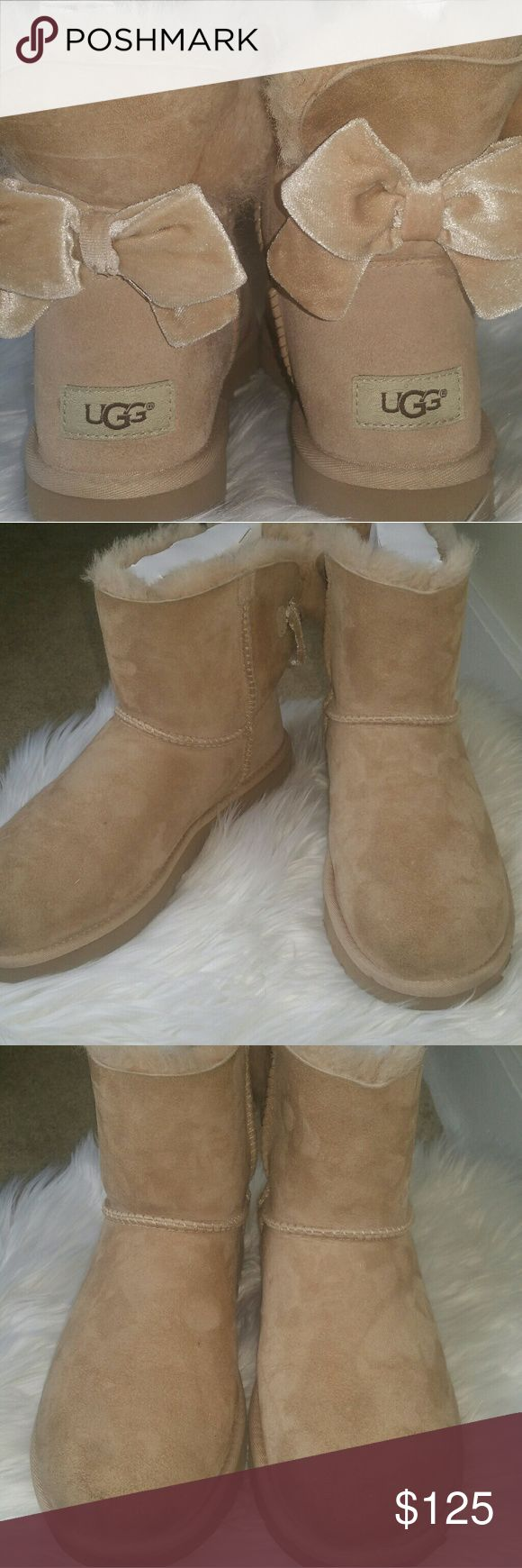 Ugg bailey bow II pink. Price not firm. Worn twice. Got a small stain on it and said I can't with this color..and bow in back needs to be re-sewn better. Other than that these are perfect authentic uggs.. I wear a size 9.. these fit perfectly . This is a size 8..accepting offers..:) purchased in December.. I will accept  reasonable offers. Please use the offer button.. UGG Shoes Winter & Rain Boots