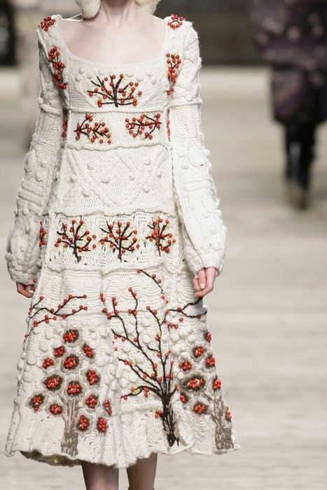 Off-white knit dress with cables and bobbles is adorned with red crochet flowers and trees. Kenzo Fall/Winter 2009