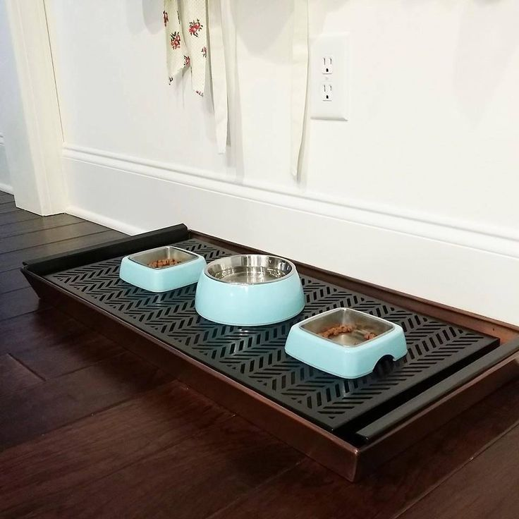 Have problems keeping your pet feeding area clean? If so,try using a boot tray! I use this for my 2 cats & have no issues with food or water spilling all over the floor anymore. The extra food falls between and I clean it out once a week. No more messes! (Tray is from Target)