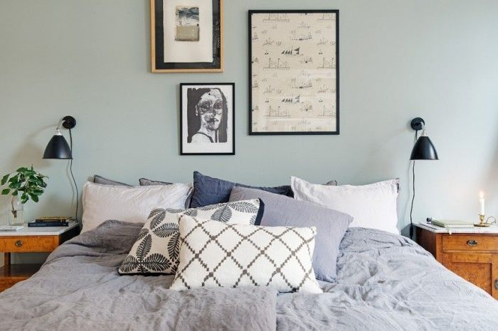 Bedroom with green walls, a picture wall, wall lamps and linen bedding. The home of blogger and stylist Johanna Bradford.