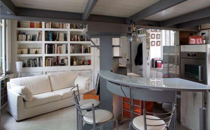 Arredare casa in affitto - Zona giorno con isola e sgabelli