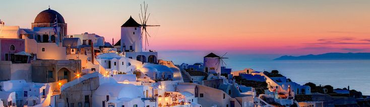 Greek Island Cruises and Sailing. A great combination. This is a view of Santorini at sunset.