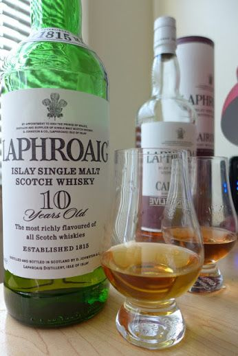 """Laphroaig 10 Year Old Single Malt Scotch Whisky from the remote island of Islay in the Western Isles of Scotland. Laphroaig, pronounced """"La-froyg"""".is a Gaelic word meaning """"the beautiful hollow by the broad bay"""" Cheers to Laphroaig."""