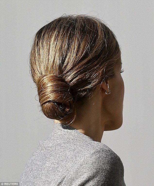 Letizia opted to keep her bobbed hair tied back in a chignon to complement her ladylike sk...