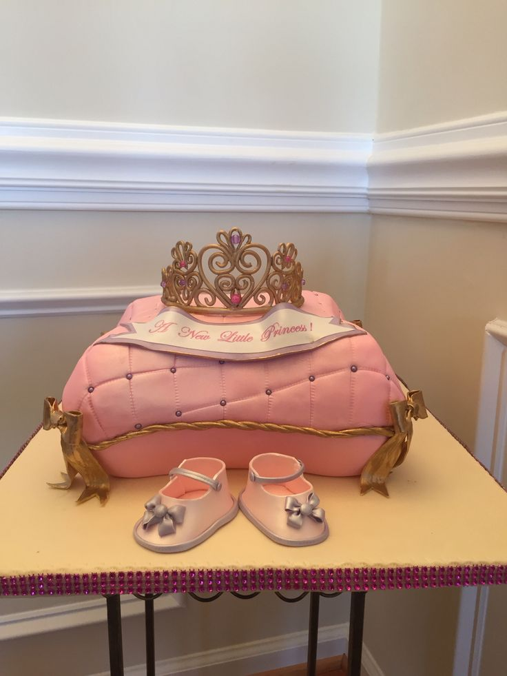 Princess pillow baby shower cake with a edible crown.