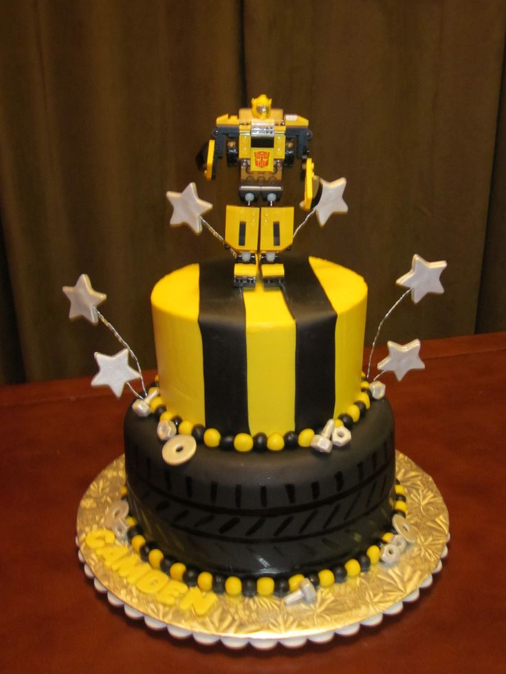 """Bumblebee Transformer - My son't 4th birthday cake. 8"""" and 6""""/ Bottom is fondant covered and top is buttercream with fondant stripes. Topper is a lego bumblebee that he was wanting. Inspired by many cakes here on cake central. Thank you all very much for sharing your talent."""