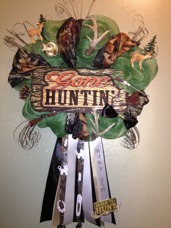 """Baby Boy Camo Wreath by WreathsMumsandMore on Etsy, $50.00"" With guns and antlers glued to it and everything. Lady, let me tell you something: If he was ""born to hunt"" and is as manly as this wreath implies, HE'S NOT GOING TO WANT TO DECORATE WITH IT."