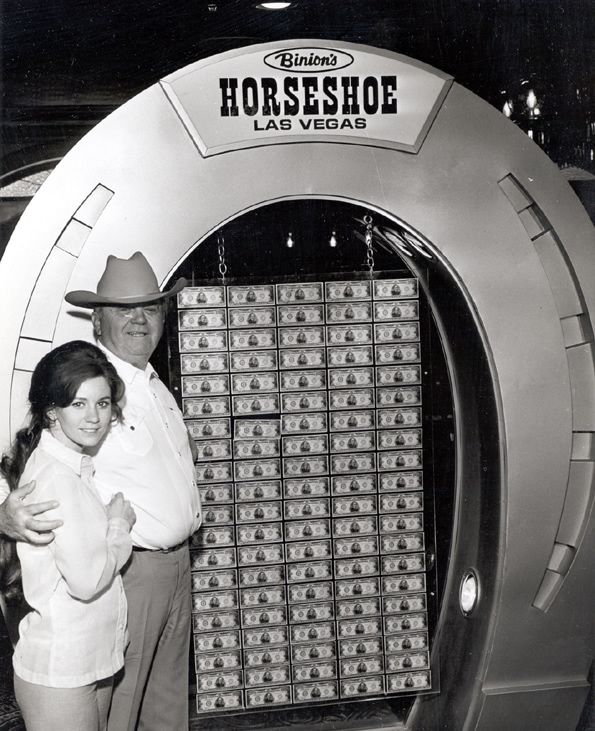 Benny Binion and his $1,000,000 display at Binion's Horseshoe, Las Vegas, 1969. Before coming to Las Vegas and building a gambling empire, Binion was a Texas cowboy, bootlegger, mobster, murderer, convicted felon and poker enthusiast. He opened the Horseshoe Club in 1951, but was sidelined a few years in Leavenworth prison for tax evasion.