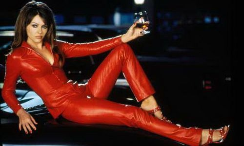 Liz Hurley posing in a red Leather Catsuit | Red Leather ... Christian Bale House