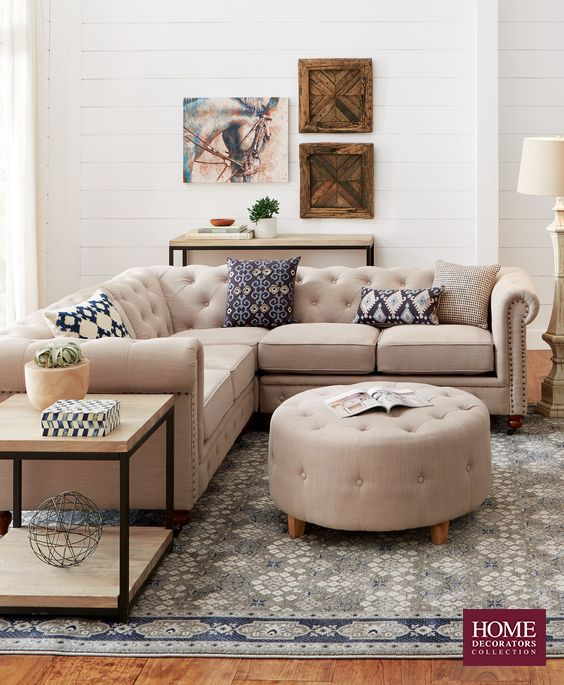 Not your average sectional, this Chesterfield-style piece has ample seating and beautiful details. Button tufts around the back cushions and bottom edge add a stylish touch. It's finished with hand-applied nailhead trim. You'll love this look. Give your room a spot to sit that's not only functional but also stylish. Available at Home Decorators Collection.