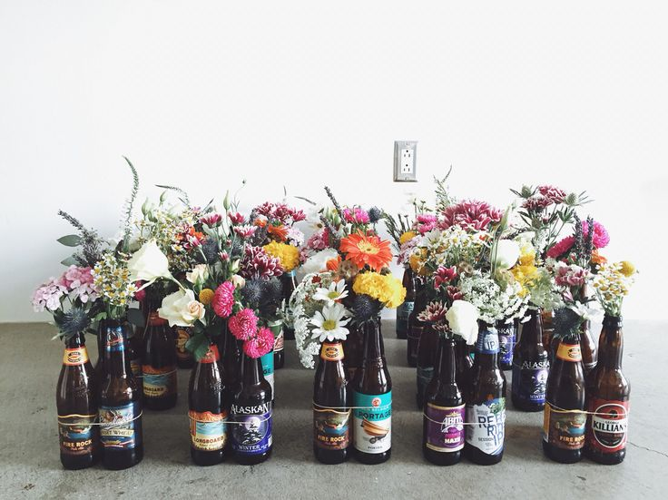 60 craft beer bottle centerpieces arranged into groups of 3 and ready for boxing up for delivery! @foxglove_losangeles