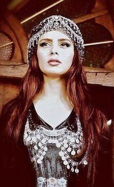 Kurdish silver jewelry (2010s) on traditional dress, from Iraqi Kurdistan.  Model: singer Hanî.