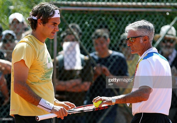 Swiss tennis player Roger Federer (L) chats with his new Spanish coach Jose Higueras (R) during their training session at Jamor Stadium in Lisbon on April 14, 2008 in Estoril. Federer starts his competition at Estoril Open on 15 April, facing Belgium's Olivier Rochus.