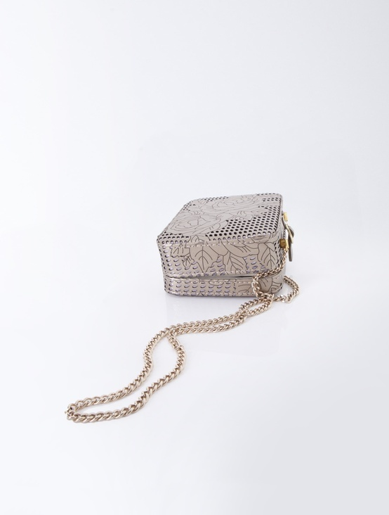 Openwork patterned bag on a long chain.