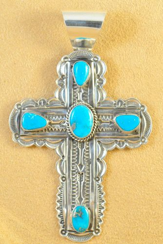 Handmade cross pendant, with natural rare gem grade Blue Gem Turquoise, by Navajo artist Andy Cadman.